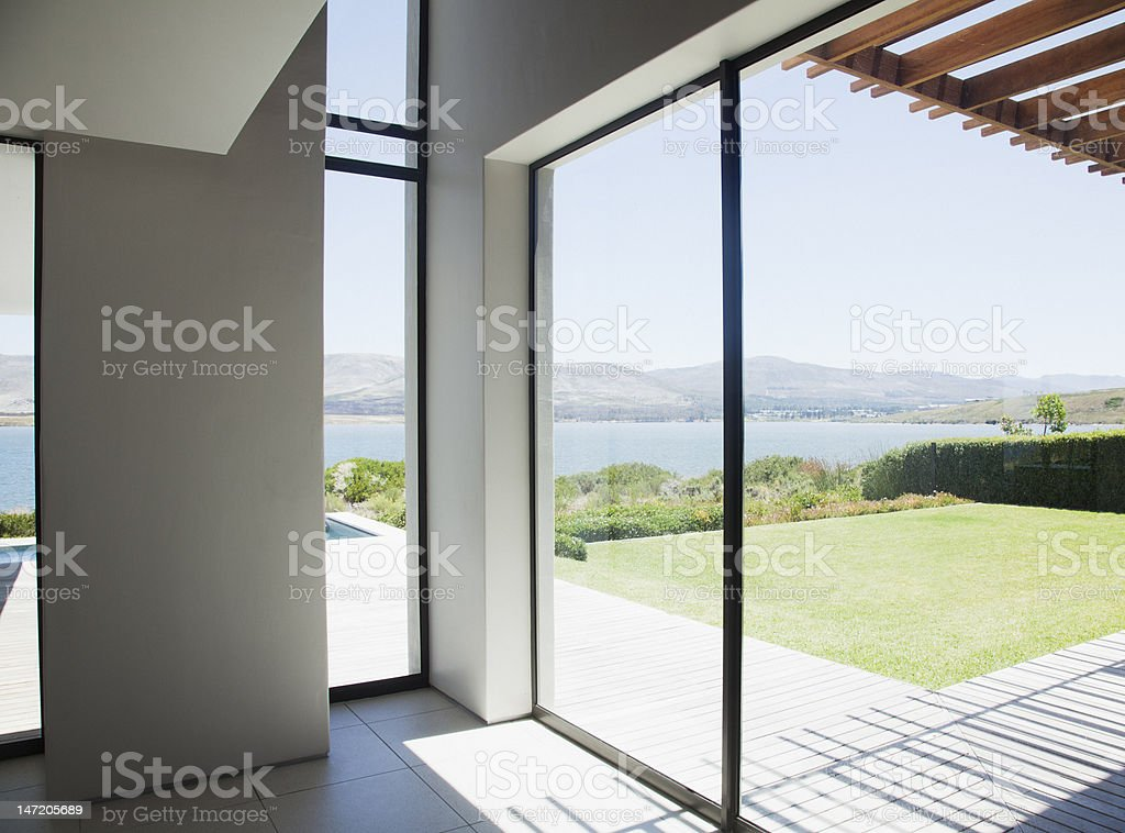 View of lake from window of modern house royalty-free stock photo