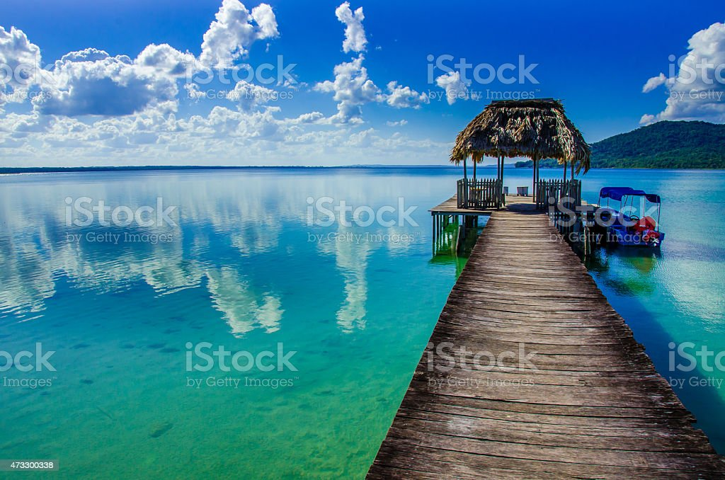 View of Lake Peten, Guatemala from pier stock photo
