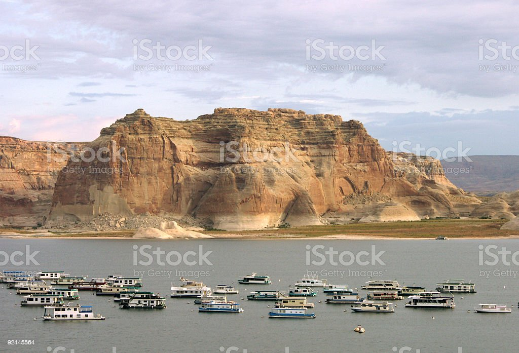 View Of Lake Powell And Boats During Sunset royalty-free stock photo