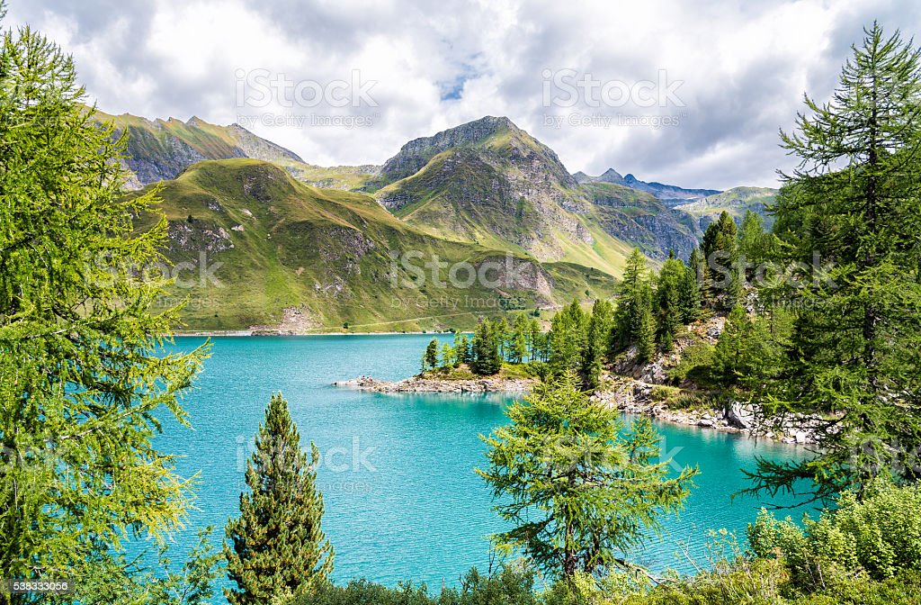 View of lake Ritom with the Alps in background, Switzerland stock photo