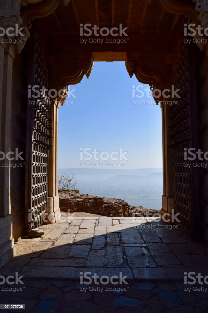 View of landscape through gate stock photo