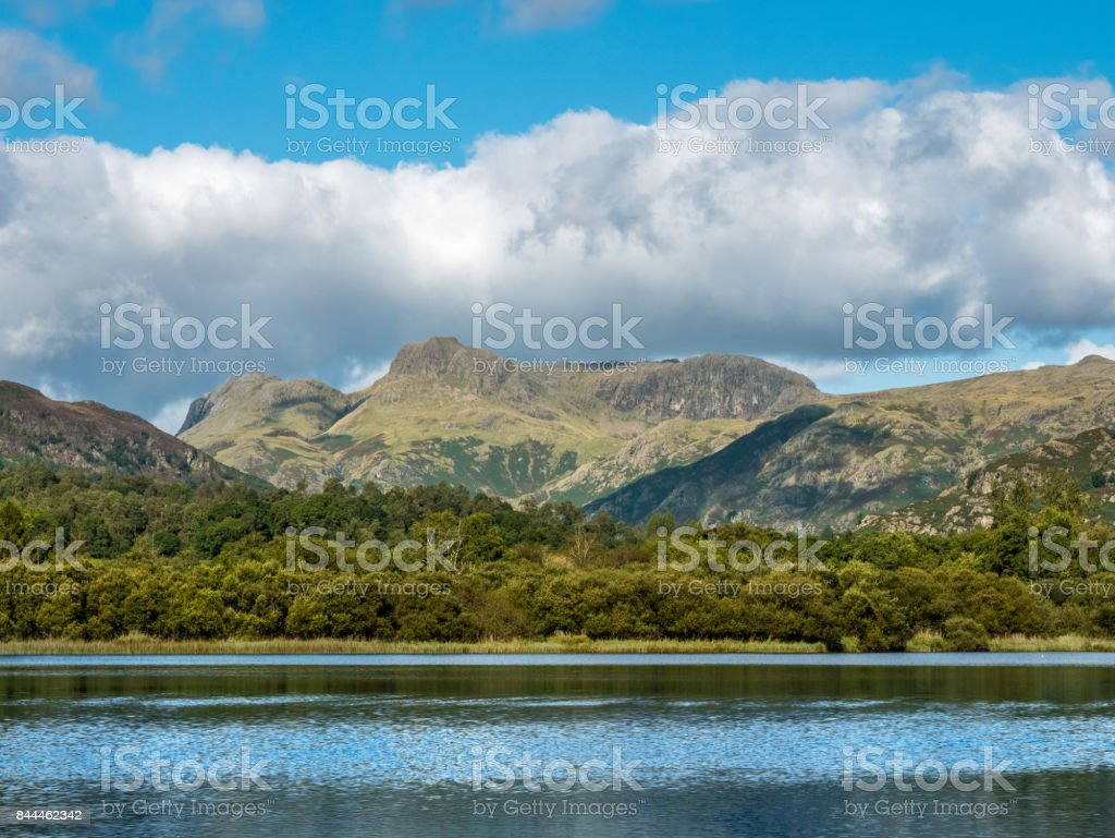 View of Langdale Fells across Elterwater in Cumbria, England stock photo