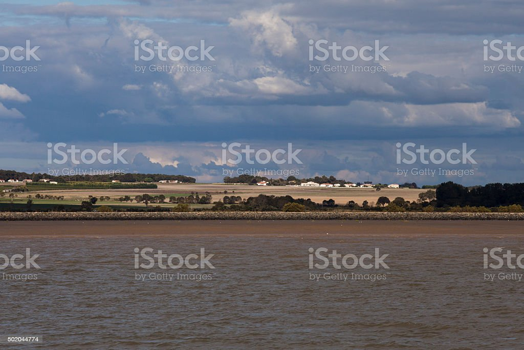 View of limestone cliffs Meschers/Gironde with troglodytic houses, France stock photo