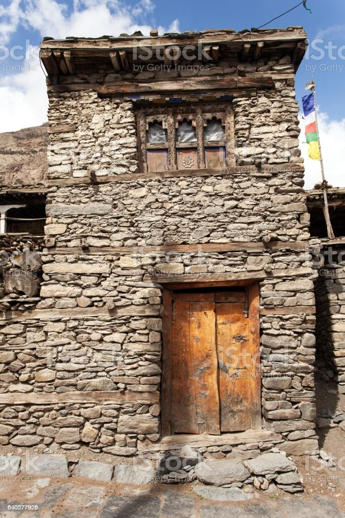View of local stony building in Manang village stock photo