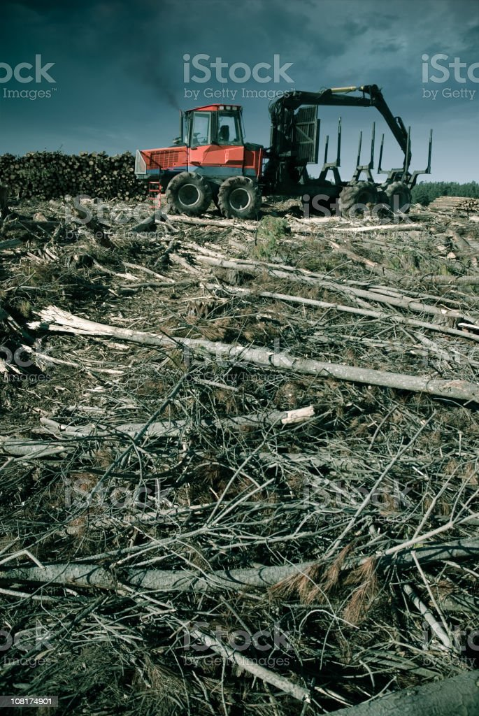View of machine depicting remnants of deforestation  stock photo