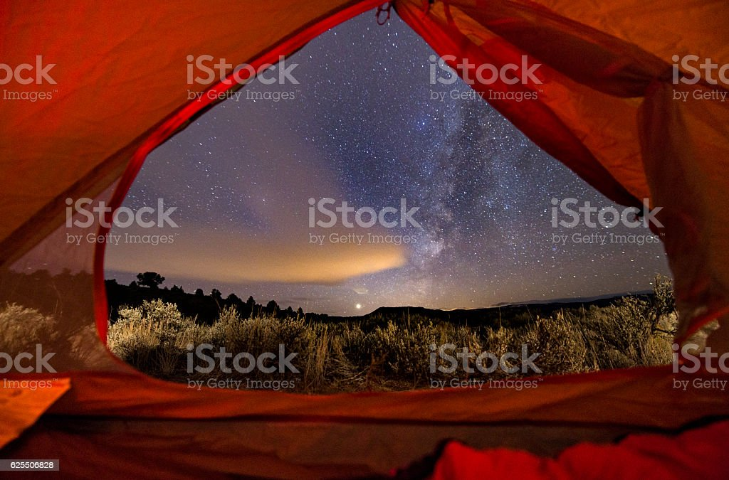 View of Milky Way Galaxy Looking Out Tent Camping stock photo