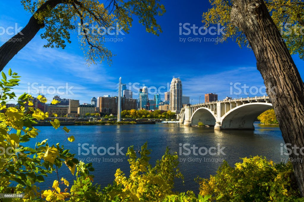 View of Minneapolis, surrounded by autumn colored trees stock photo