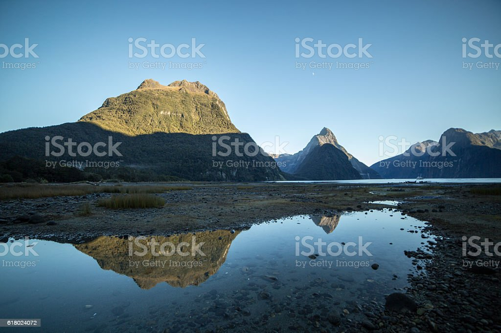 View of Mitre peak and mountains in Fiordland National park stock photo