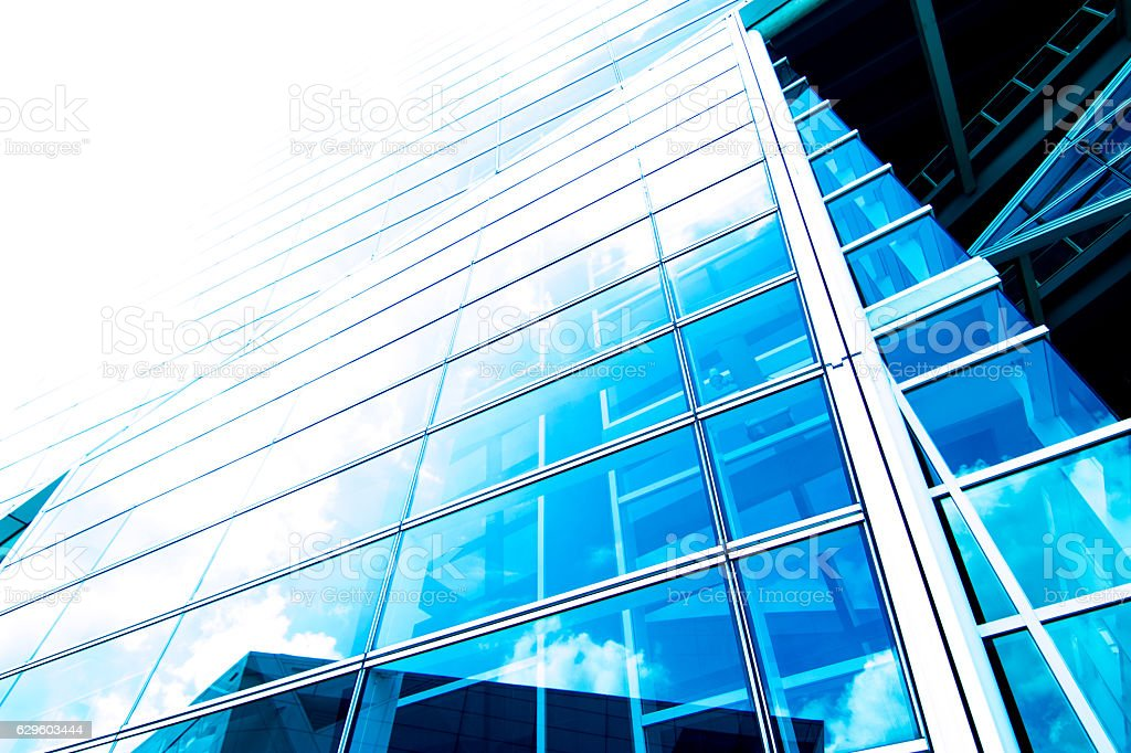 View of modern contemporary glass skyscraper reflecting the blue sky stock photo