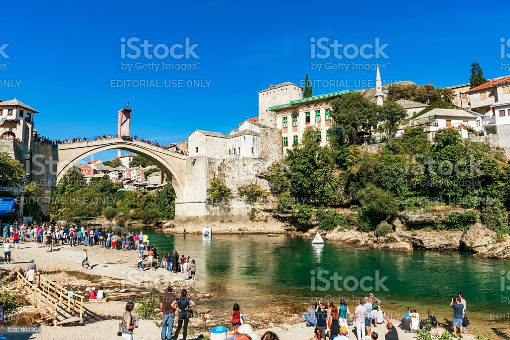 View of Mostar old town from a beach stock photo