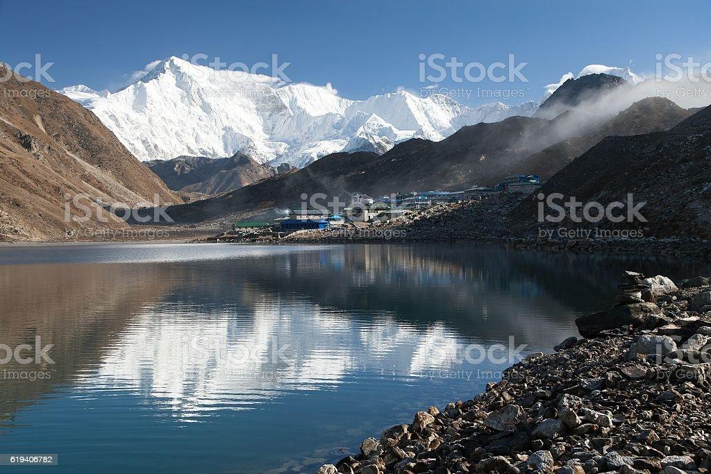 View of mount Cho Oyu mirroring in Gokyo lake stock photo