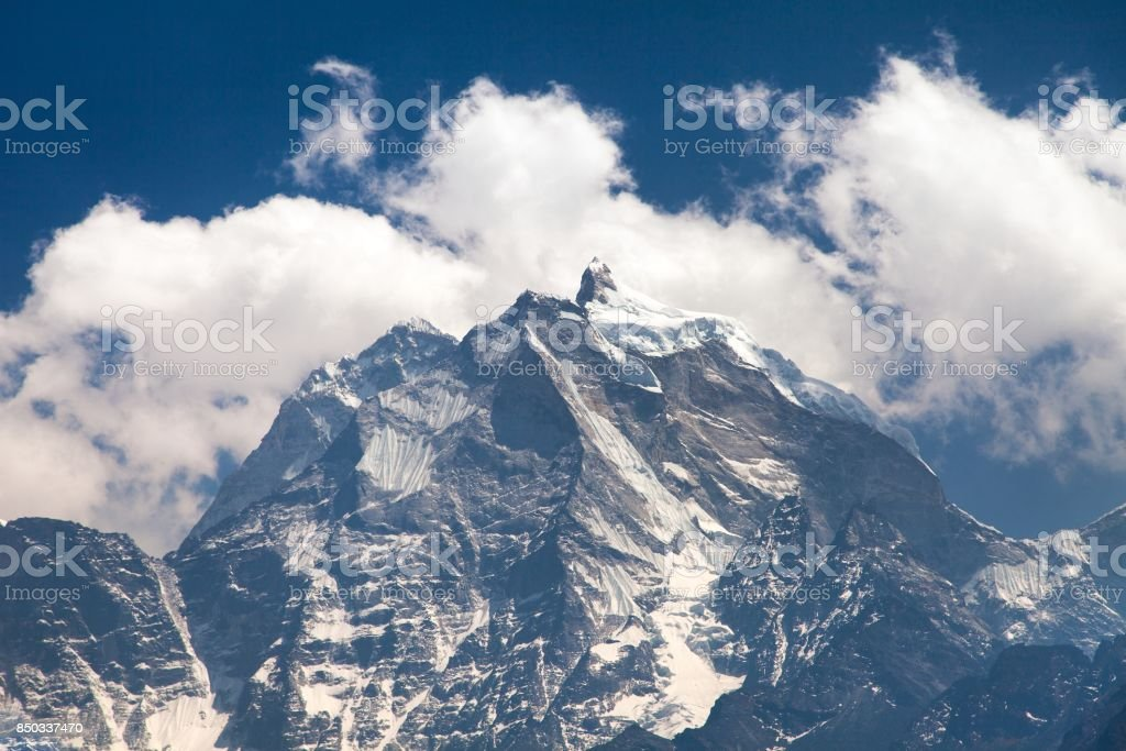 View of mount Kangtega in the middle of clouds stock photo