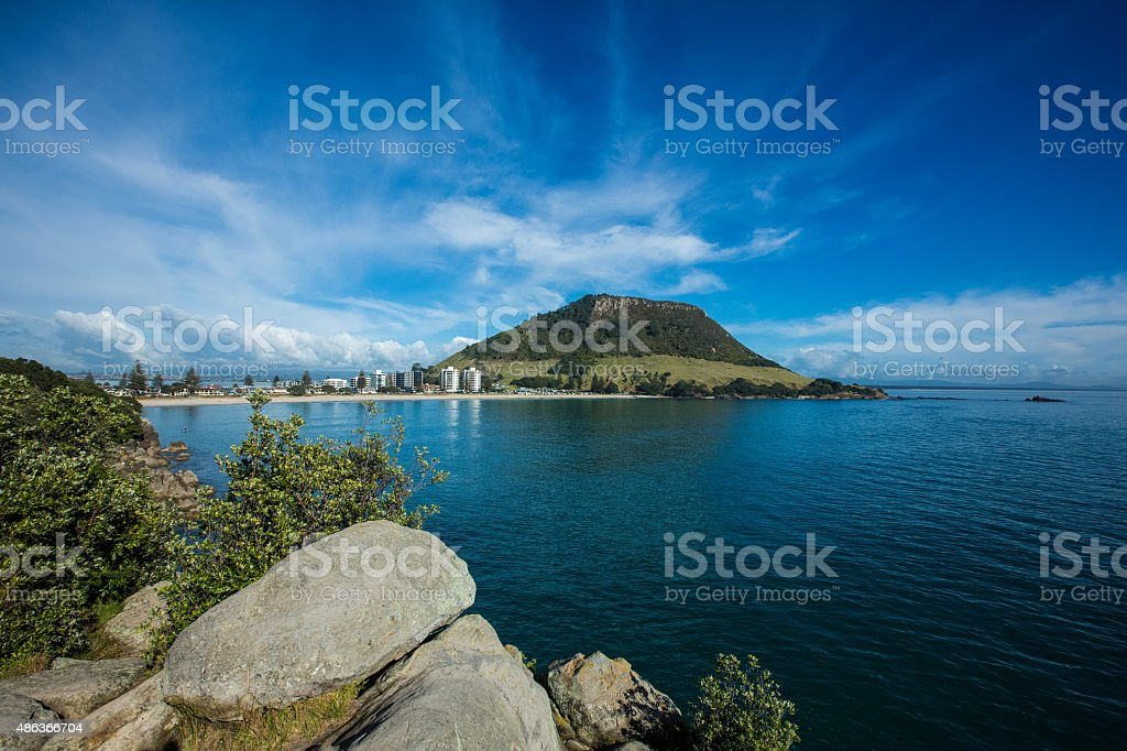 View Of Mount Maunganui across beach stock photo