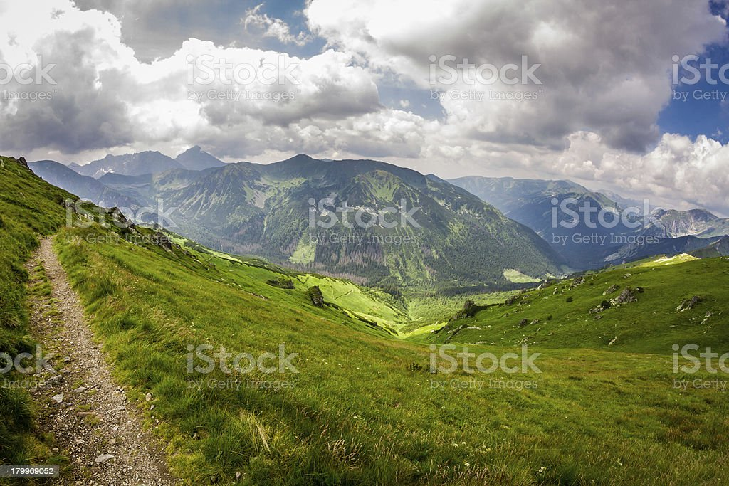 View of mountain peaks from the trail in summer royalty-free stock photo