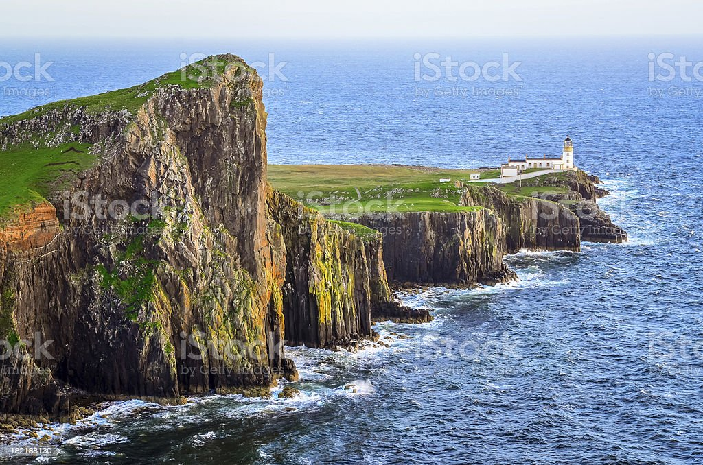 View of Neist Point lighthouse and rocky ocean coastline, Scotland stock photo