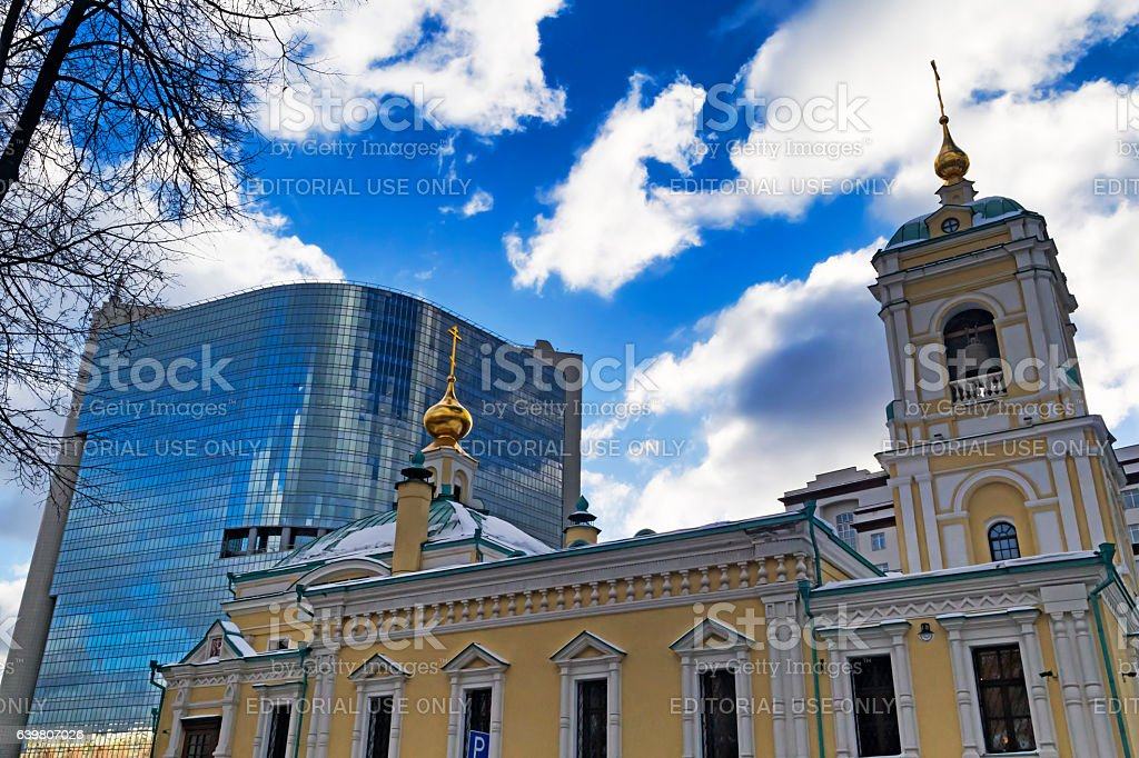 View of new Church and Commercial Center in cloudy sky stock photo