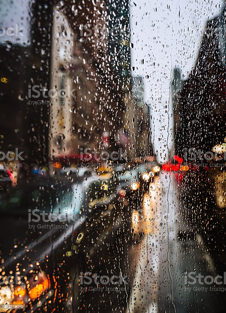 Blurred New York City street background with waterdrops, lights and...