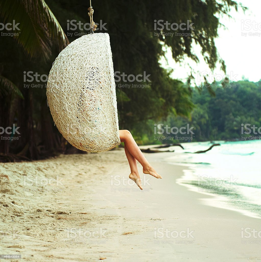 view of nice womans legs in tropical bliss stock photo