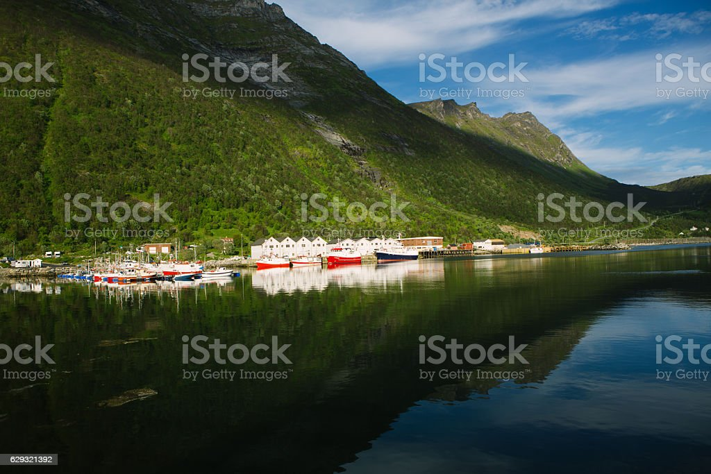 view of norwegian fisherman village Husoy, Senja island, Norway stock photo