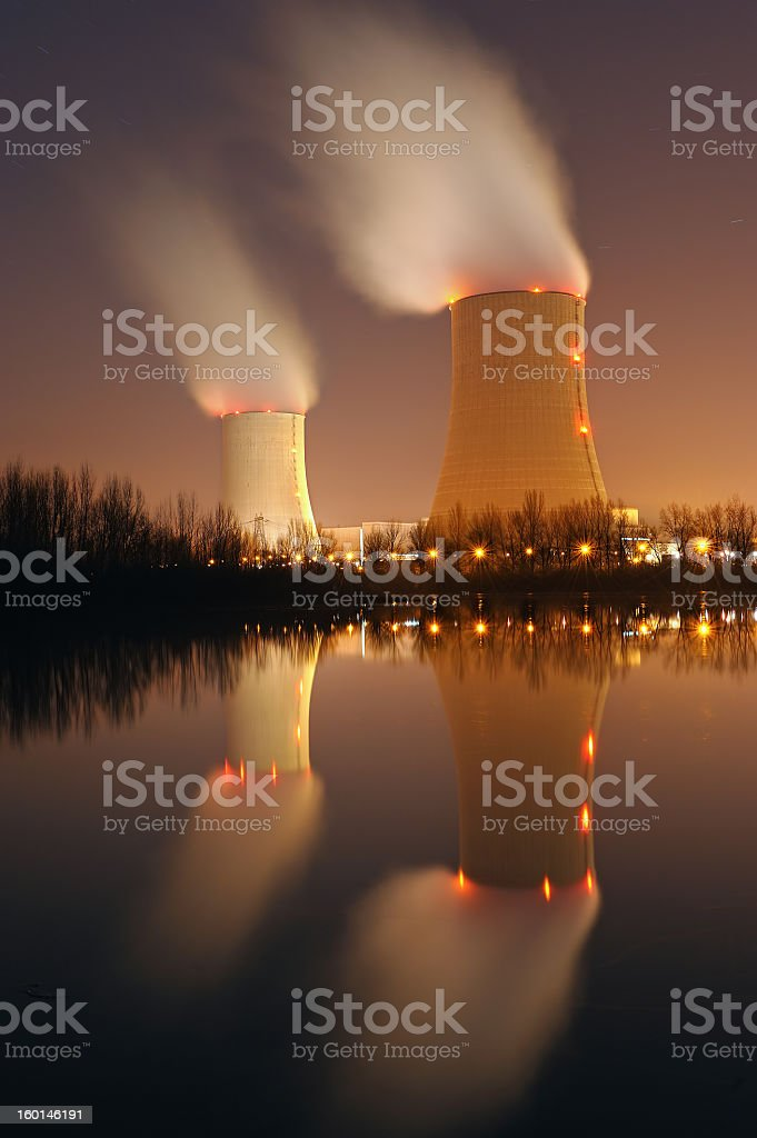 View of nuclear power plant with fumes coming out  stock photo