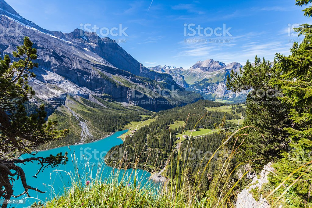 View of Oeschinensee (Oeschinen lake) and the valley on bernese stock photo