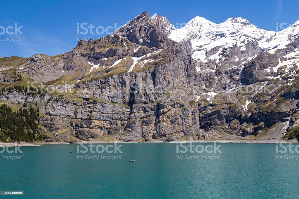 View of Oeschinensee lake with Bluemlisalp and Frundenhorn alps, Switzerland stock photo