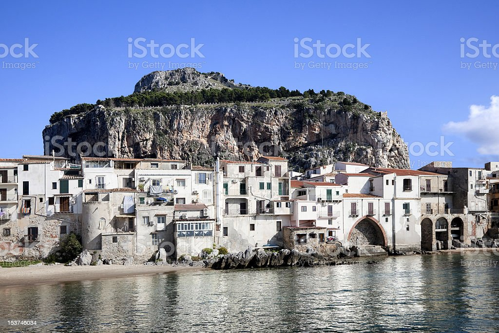 View of Old Buildings and mountain at Cefalu Beach Italy stock photo