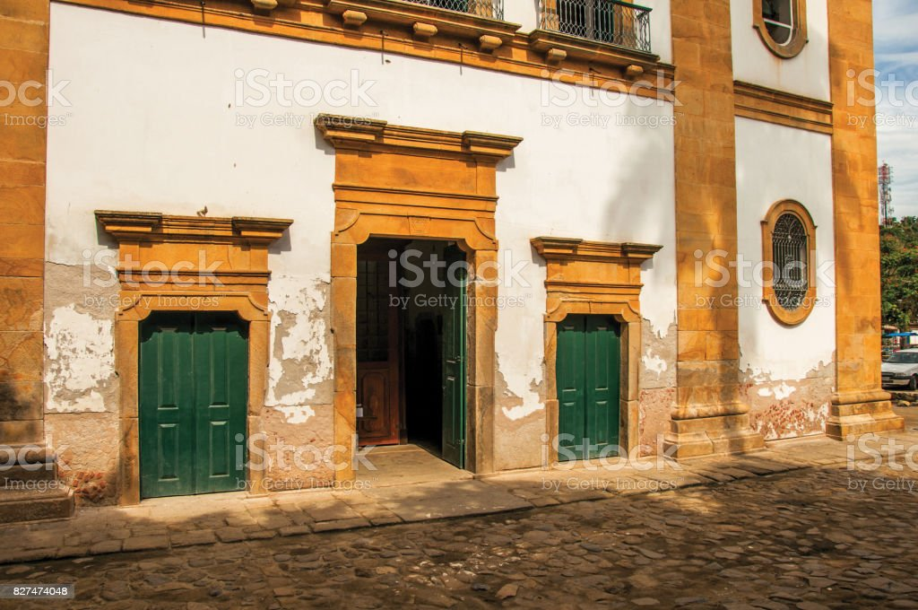 View of old colored church doors and cobblestone street in Paraty. stock photo