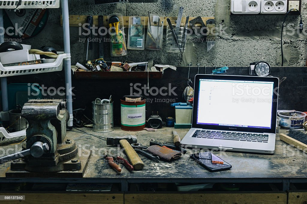View of old tools,laptop and phone on table stock photo