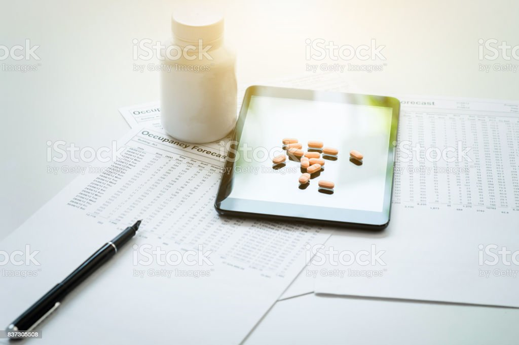 View of pad, drug and equipment on foreground table, Health care and Medical concept stock photo
