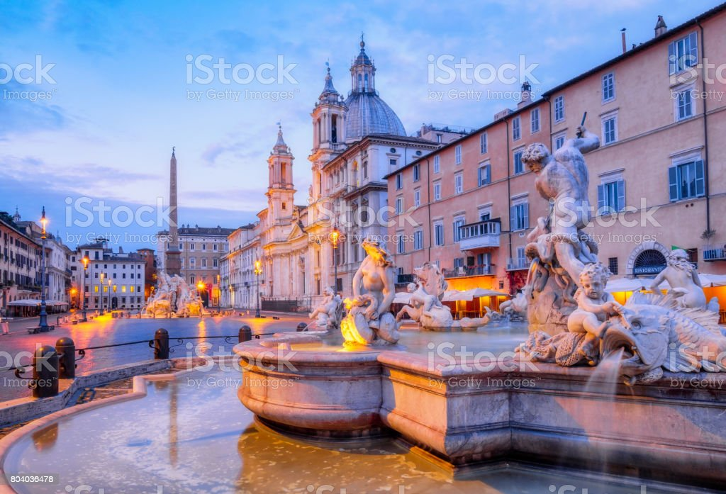 View of Piazza Navona and fountain before sunrise, Rome stock photo