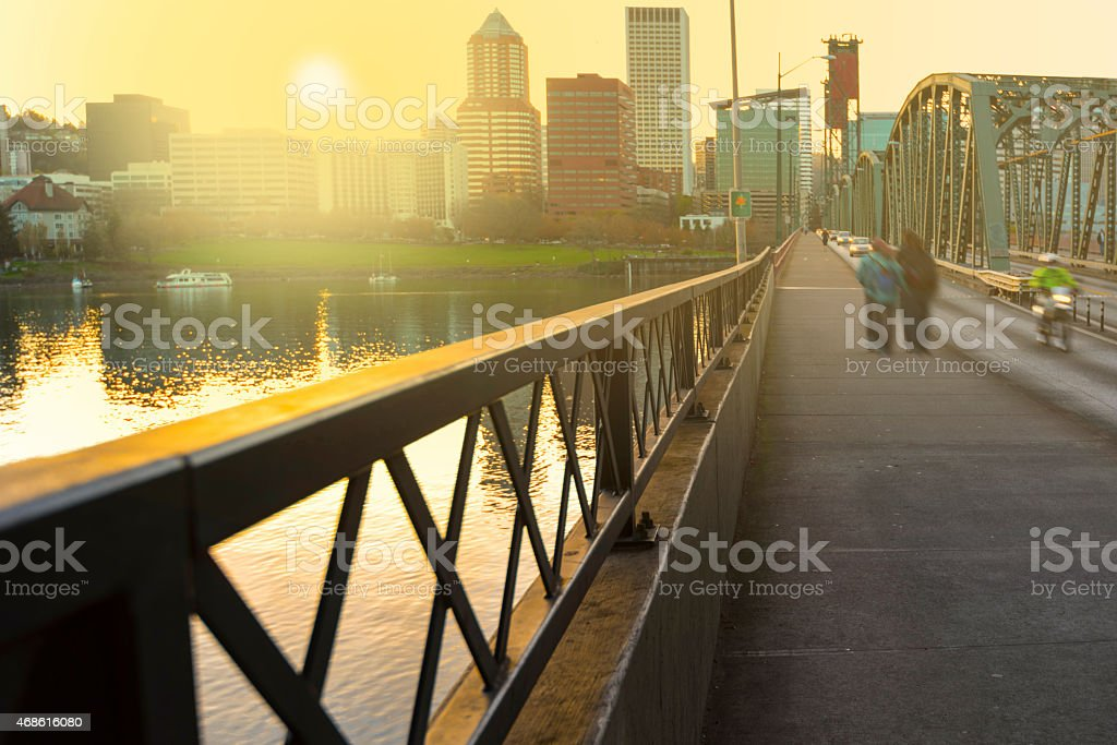 A view of Portland as the sun sets on a downtown bridge stock photo