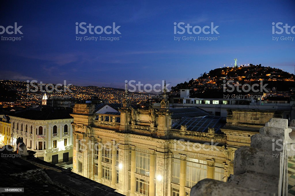 View of Quito at nighttime with city in the background stock photo