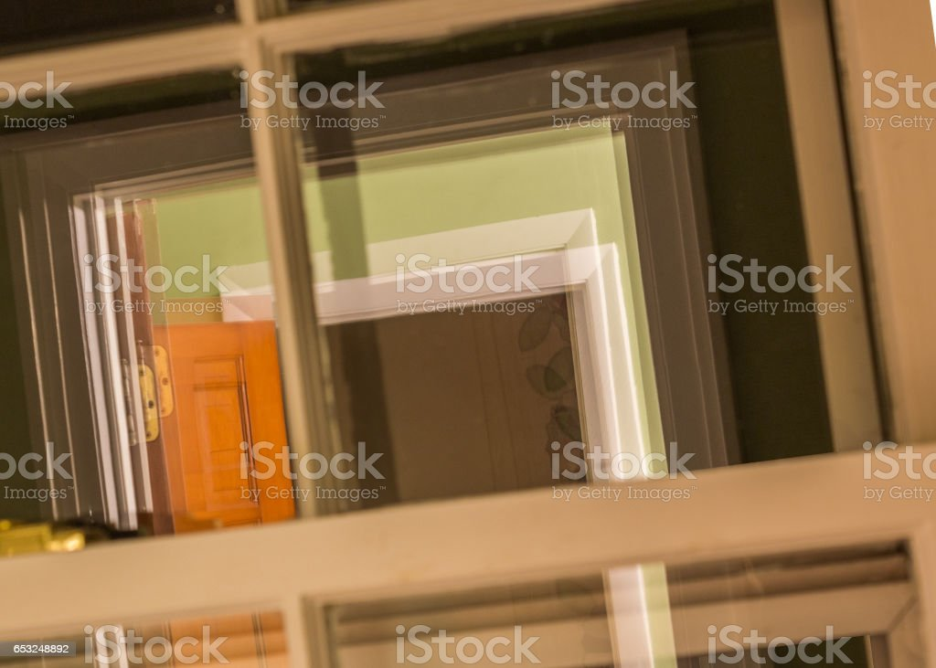View of receding doorways reflected in a double paned window stock photo