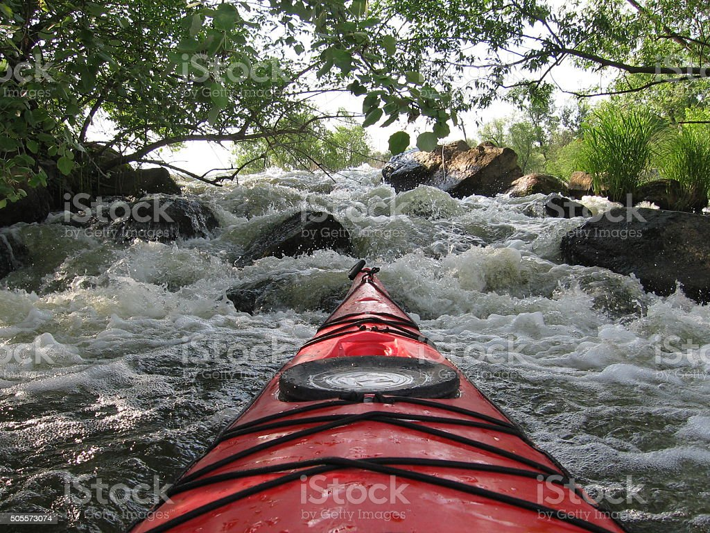 View of red kayak on white water rapids stock photo