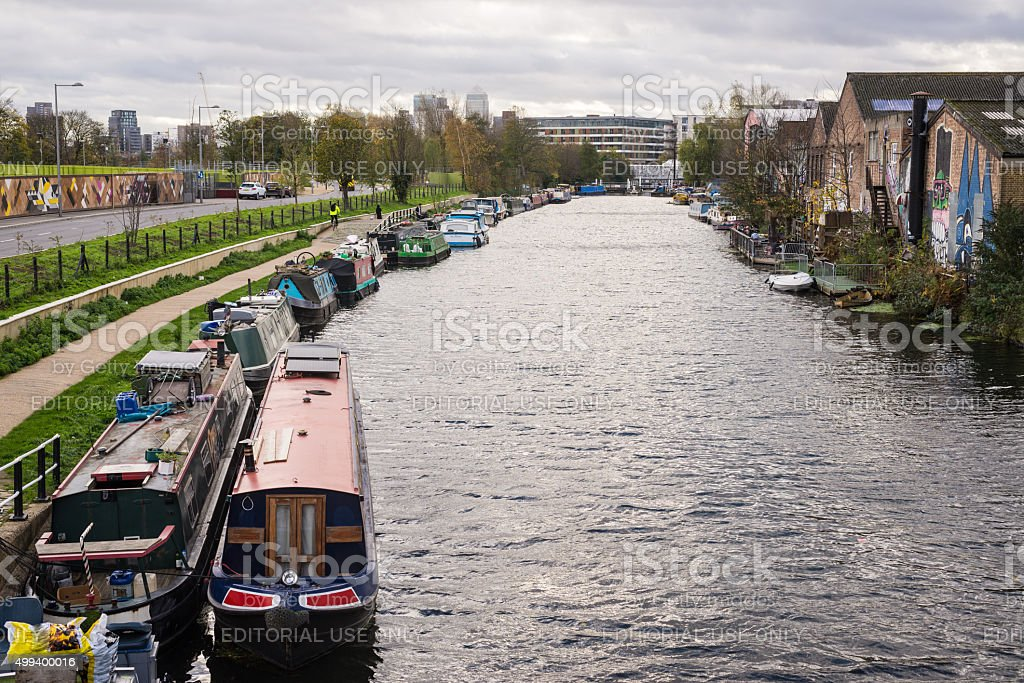 View of Regent's canal with canal boats converted to houses stock photo