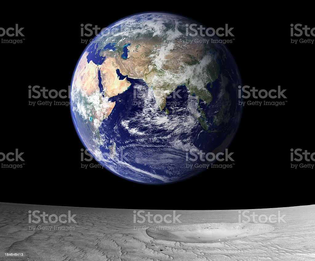 View of rising Earth from the moon's surface royalty-free stock photo