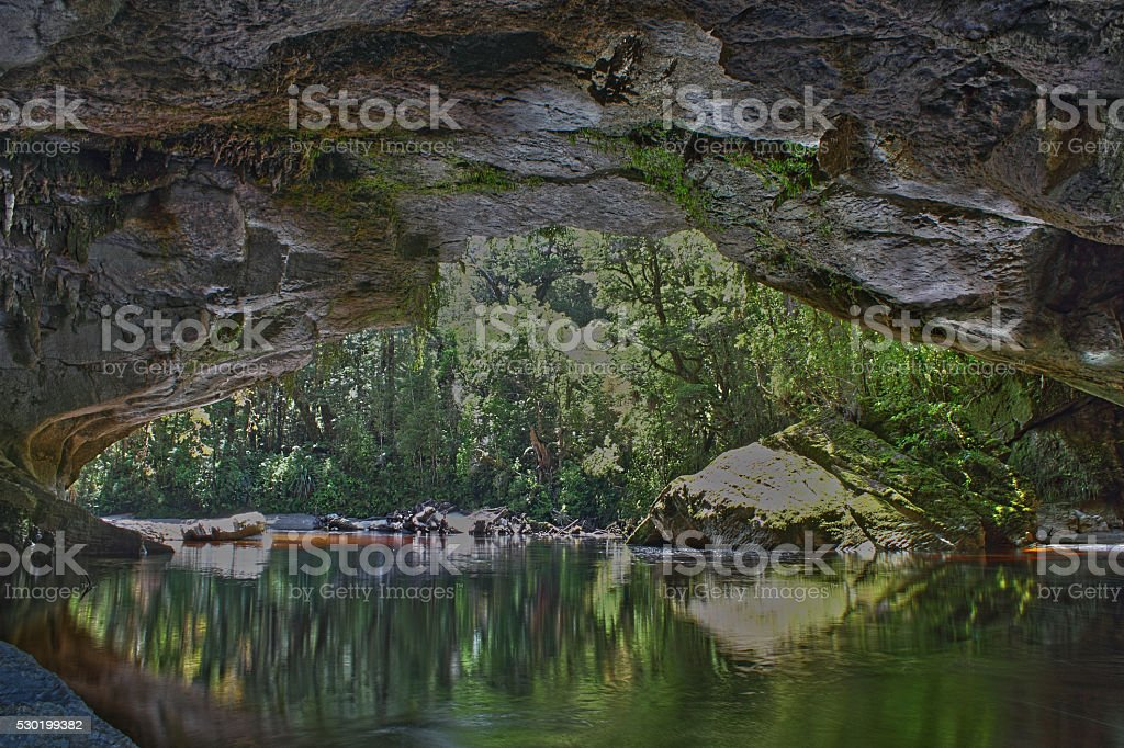 View of River from underneath Oparara Arch, New Zealand stock photo