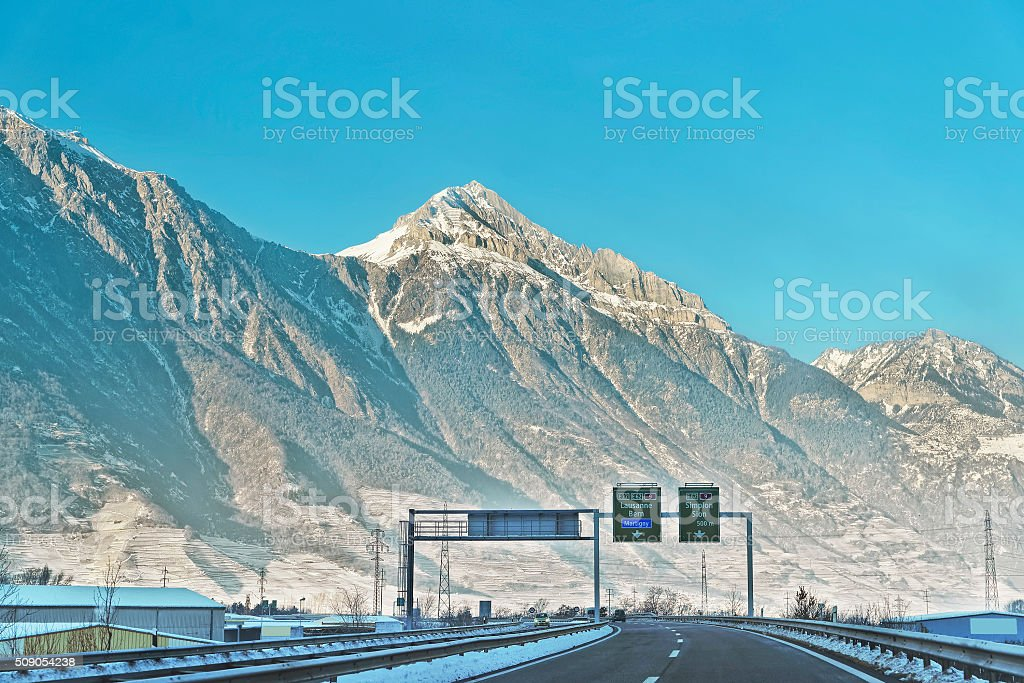 View of road with road sings in Switzerland in winter stock photo