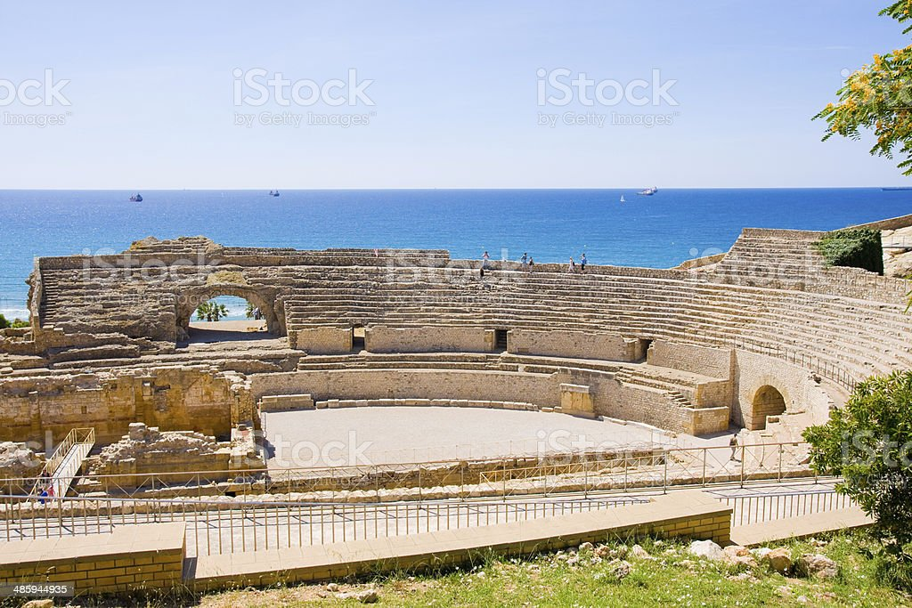 view of roman amphitheater against sea in Tarragona, in Spain royalty-free stock photo