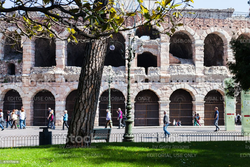 view of roman Arena from garden on Piazza Bra stock photo
