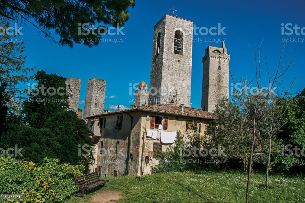 View of rooftops and towers with garden at San Gimignano. stock photo