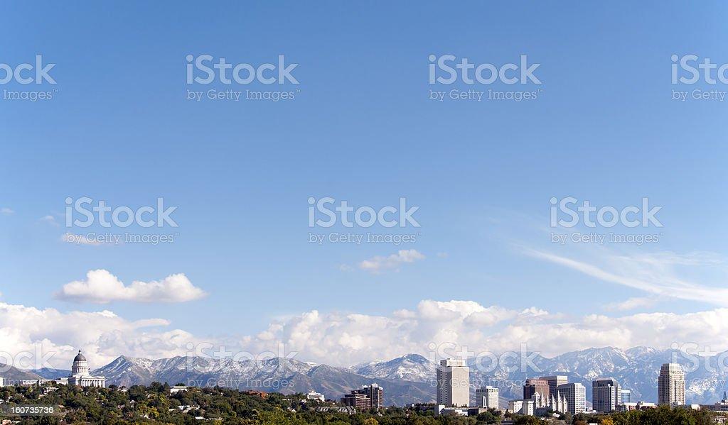 View of Salt Lake City skyline against blue sky stock photo