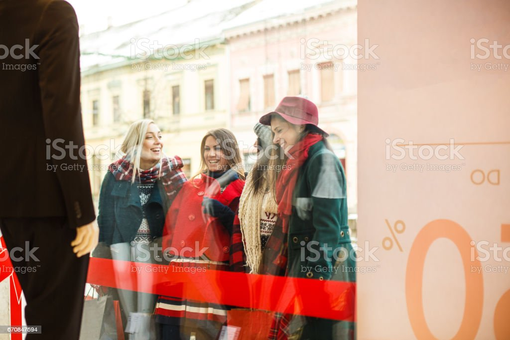 View of satisfied girls after shopping stock photo
