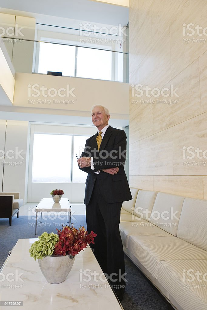 View of senior executive standing in lobby. royalty-free stock photo