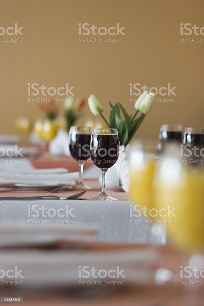 View of served table with glasses full red wine royalty-free stock photo