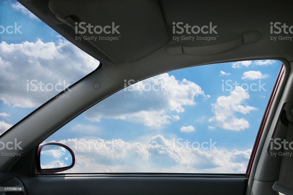 View of sky through window from inside car  stock photo
