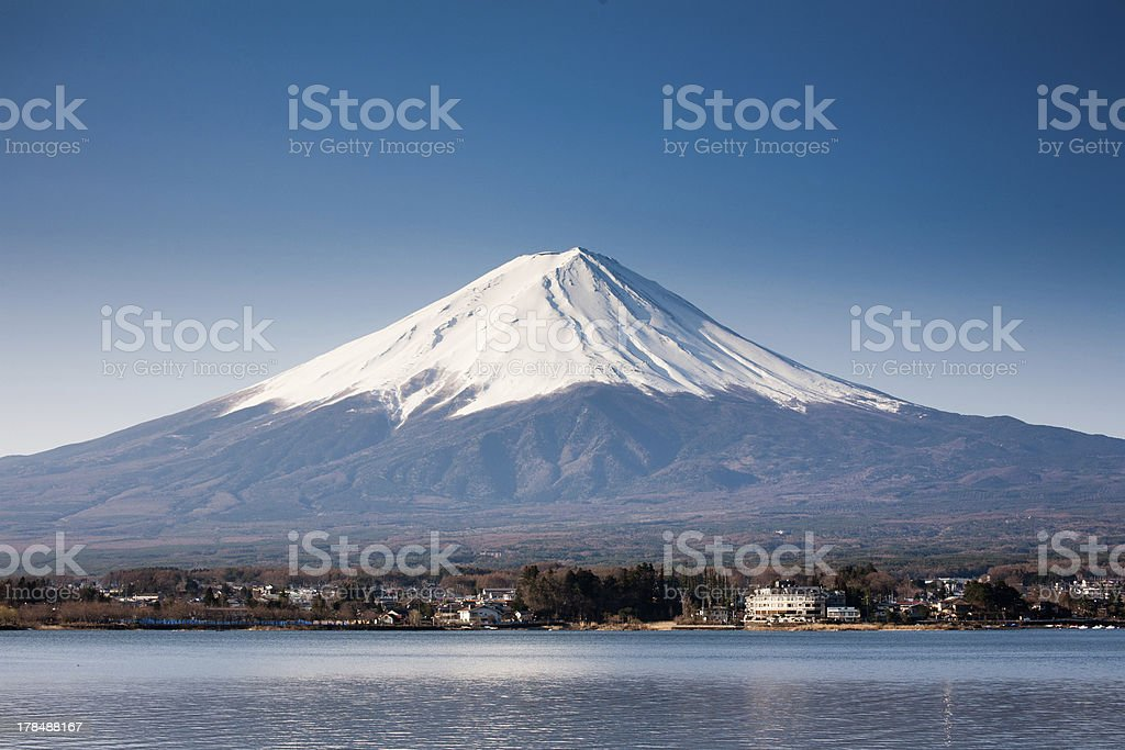 A view of snow capped Mount Fuji from the lake royalty-free stock photo