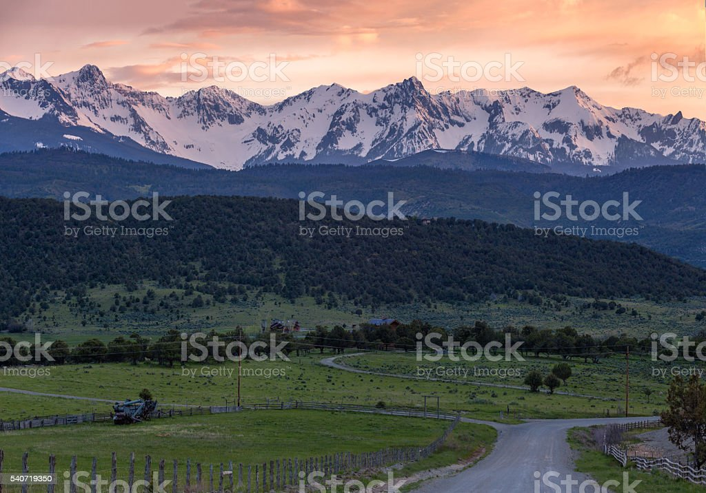 View of Snow Covered Mountains at Sunset stock photo