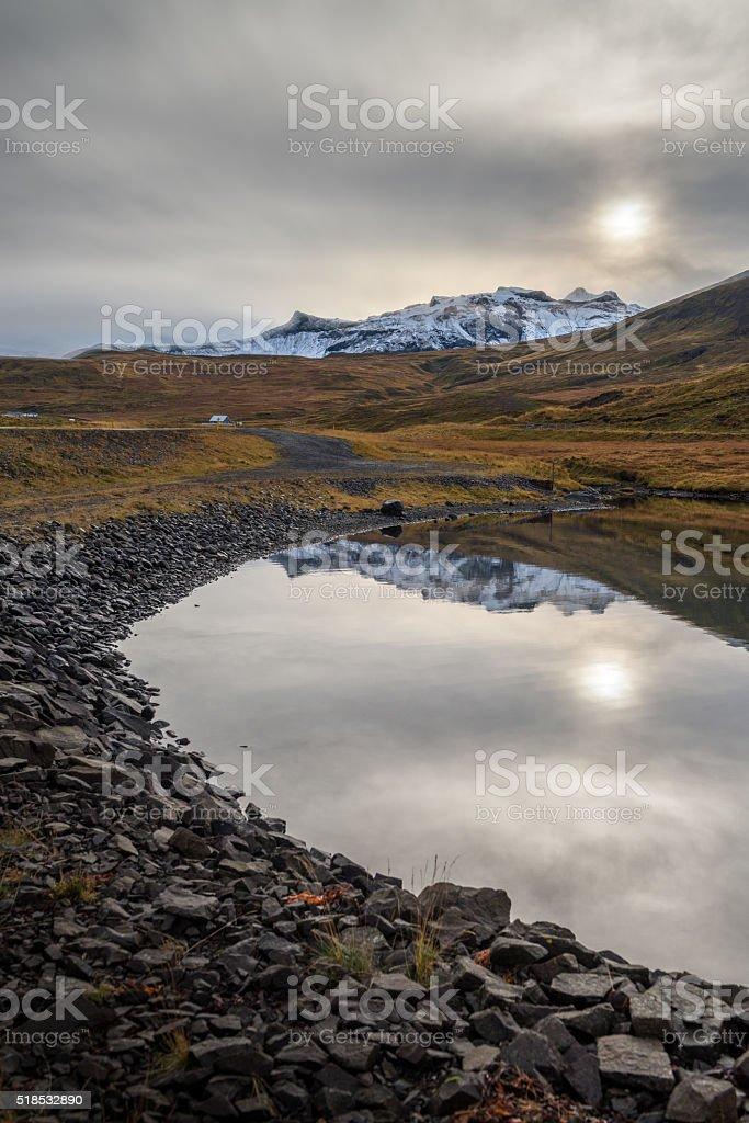 View of snow mountain range reflecting on mirror lake stock photo